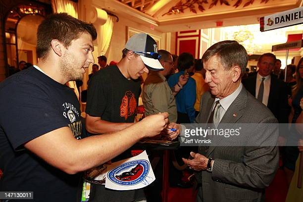 Former NHL player Ted Lindsay signs an autograph as he arrives before the 2012 NHL Awards at the Encore Theater at the Wynn Las Vegas on June 20 2012...