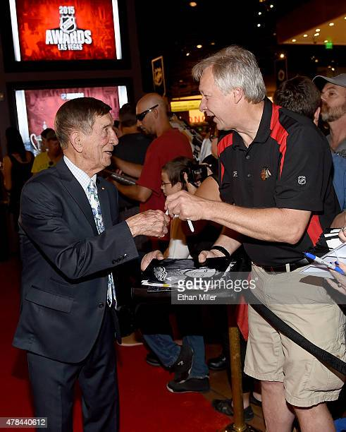 Former NHL player Ted Lindsay signs autographs as he arrives the 2015 NHL Awards at MGM Grand Garden Arena on June 24 2015 in Las Vegas Nevada