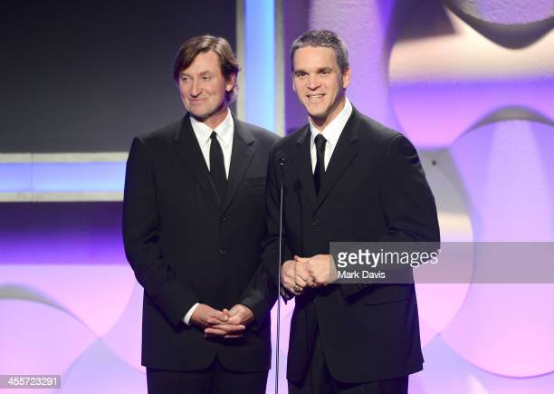 Former NHL player Wayne Gretzky and Los Angeles Kings Business Operations President Luc Robitaille speak onstage during the 27th American...