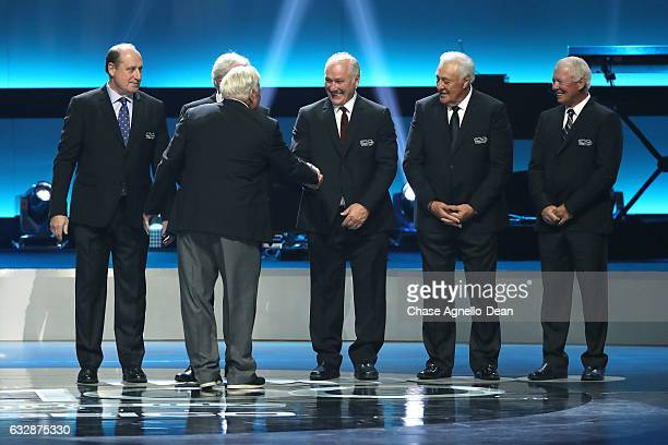 Former NHL players Bob Gainey Bobby Hull Gilbert Perreault Phil Esposito and Bobby Clarke stand onstage during the NHL 100 presented by GEICO show as...