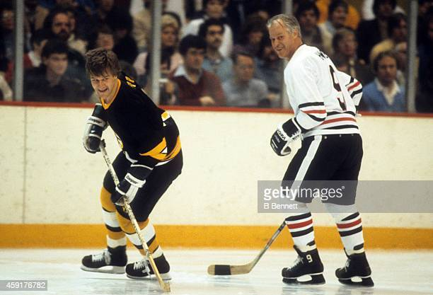 Former NHL players Bobby Orr and Gordie Howe skate on the ice during a Masters of Hockey game on February 4 1983 at the Boston Garden in Boston...