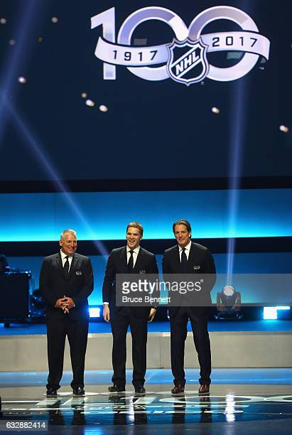 Former NHL players Brett Hull Luc Robitaille and Brendan Shanahan stand on stage during the NHL 100 presented by GEICO Show as part of the 2017 NHL...