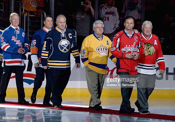 Former NHL players Brian Leetch Pat LaFontaine Gilbert Perreault Marcel Dionne Mike Gartner and Bobby Hull walk on the ice for pregame ceremonies...