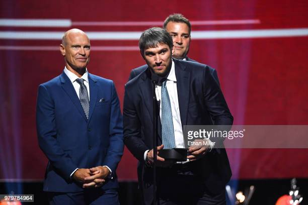 Former NHL players Mark Messier and Eric Lindros and Alex Ovechkin of the Washington Capitals present the Hart Memorial Trophy onstage at the 2018...