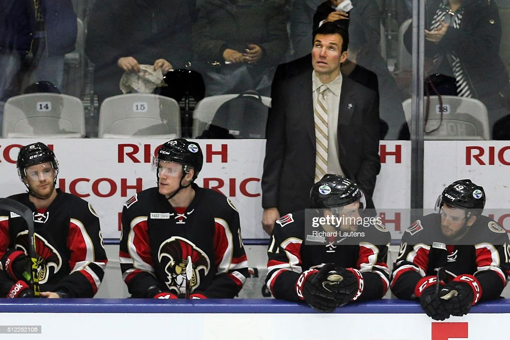 TORONTO, ON - FEBRUARY, 24 - Former NHLer and head coach of the Senators, Luke Richardson looks up at the scoreboard as the time runs down. Toronto Marlies beat the Binghamton Senators 3-1 at the Ricoh Colliseum. The morning start to the game meant that the crowd was mostly groups of school kids.