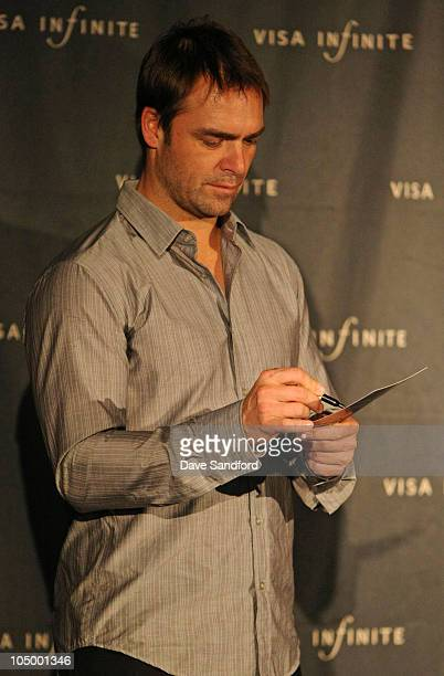 Former NHLer Curtis Joseph signs autographs during NHL FaceOff 2010 October 7 2010 in Toronto Ontario Canada