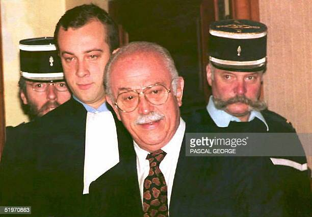 Former Nice mayor Jacques MTdecin arrives 29 March at the Grenoble court with his lawyer Alexandre Varaut for the opening of his trial Medecin who is...