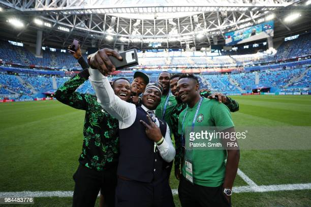 Former Nigeria International Daniel Amokachi poses for a selfie with members of Nigeria squad prior to the 2018 FIFA World Cup Russia group D match...