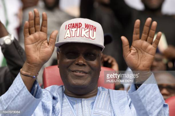 Former Nigerian vicePresident Atiku Abubakar raises his hands after winning the presidential ticket of the opposition People's Democratic Party...