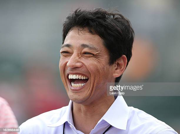 Former Nippon Professional Basebal Member So Taguchi watches the pregame warms ups prior to the start of the game between the St Louis Cardinals and...