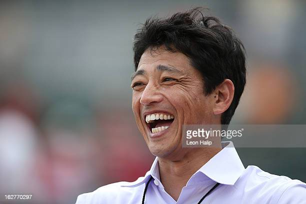 Former Nippon Professional Baseball Member So Taguchi watches the pregame warms ups prior to the start of the game between the St Louis Cardinals and...
