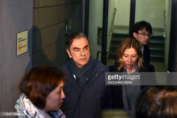 TOPSHOT Former Nissan Chairman Carlos Ghosn and his wife Carole leave the office of his lawyer Junichiro Hironaka in Tokyo on April 3 2019 Tokyo...