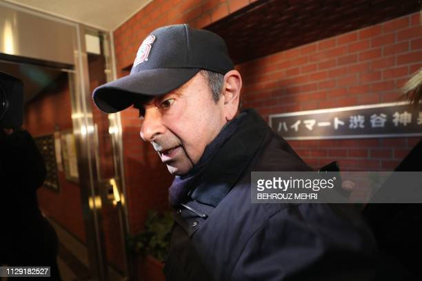Former Nissan chairman Carlos Ghosn arrives at his residence in Tokyo on March 8, 2019. - Ghosn was freed from a Tokyo detention centre on the...
