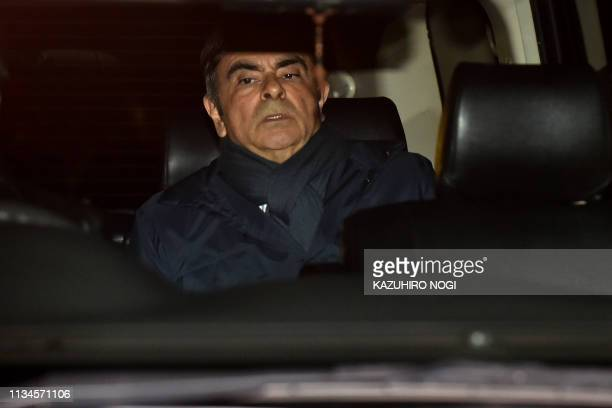 TOPSHOT Former Nissan Chairman Carlos Ghosn leaves his lawyer's office in Tokyo on April 3 2019 Tokyo prosecutors are considering pressing a fresh...