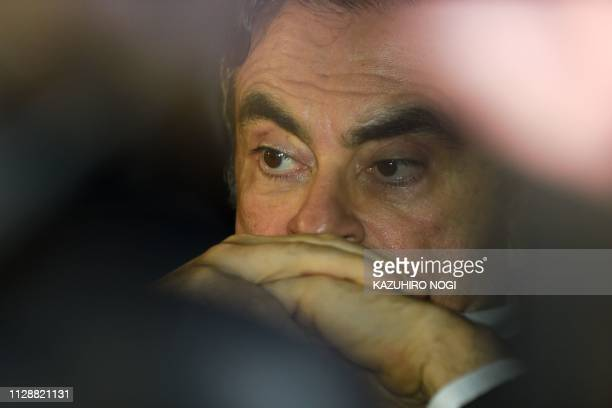TOPSHOT Former Nissan chairman Carlos Ghosn leaves his lawyers' offices after he was released earlier in the day from a detention centre after...