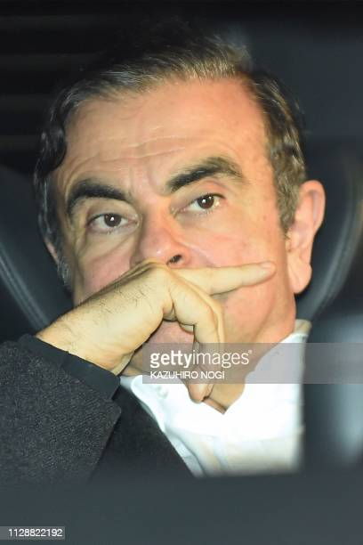 Former Nissan chairman Carlos Ghosn leaves his lawyers' offices after he was released earlier in the day from a detention centre after posting bail...