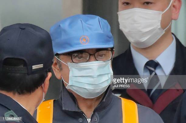 TOPSHOT Former Nissan chairman Carlos Ghosn leaves the Tokyo Detention House following his release on bail in Tokyo on March 6 2019 Ghosn posted bail...