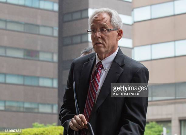 Former Nissan executive Greg Kelly arrives for a pretrial hearing at the Tokyo District Court in Tokyo on June 24 2019 Former Nissan chief Carlos...