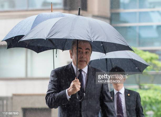 TOPSHOT Former Nissan Motor Chairman Carlos Ghosn arrives for a pretrial hearing at the Tokyo District Court in Tokyo on June 24 2019 The former...