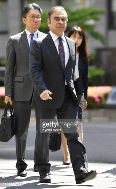 Former Nissan Motor Co Chairman Carlos Ghosn arrives at the Tokyo District Court on May 23 for the first pretrial procedures in his financial...