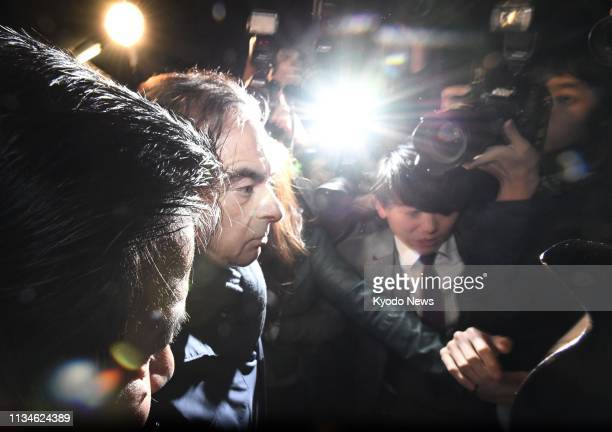 Former Nissan Motor Co Chairman Carlos Ghosn facing financial misconduct charges and released on bail leaves an office of his lawyers in Tokyo on...