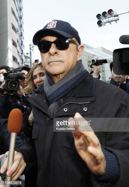 Former Nissan Motor Co Chairman Carlos Ghosn leaves a condominium building in Tokyo on March 9 2019 Ghosn was released on bail earlier this month...
