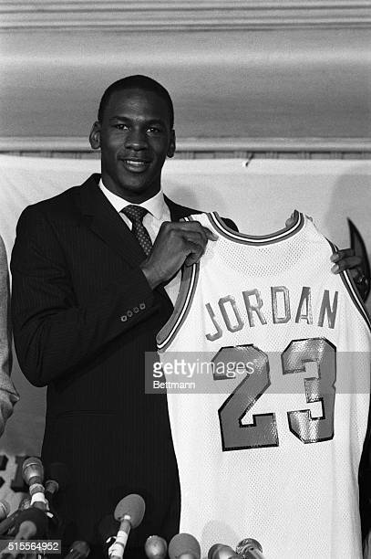Former North Carolina star College Player of the Year and star of the US Olympic gold medal winning basketball team Michael Jordan holds up his...