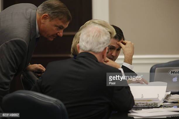 Former North Charleston police officer Michael Slager, right, confers with his attorneys during his trial in Charleston County Court November 14,...