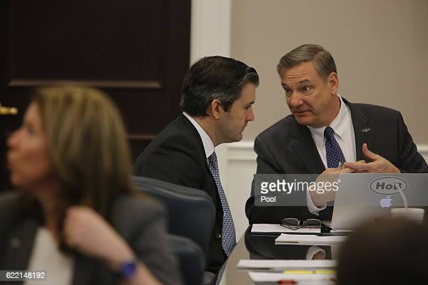 Former North Charleston Police Officer Michael Slager sits at the defense table during testimony in Slager's murder trial, November 10 in Charleston,...