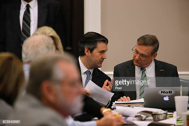 Former North Charleston police officer Michael Slager talks to a member of his defense team during his trial in Charleston County Court November 15,...