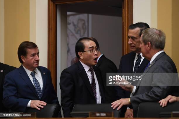 Former North Korean deputy ambassador to Britain Thae YongHo talks with US Congressman Joe Wilson RSC US Congressman Darrell Issa RCA and House...