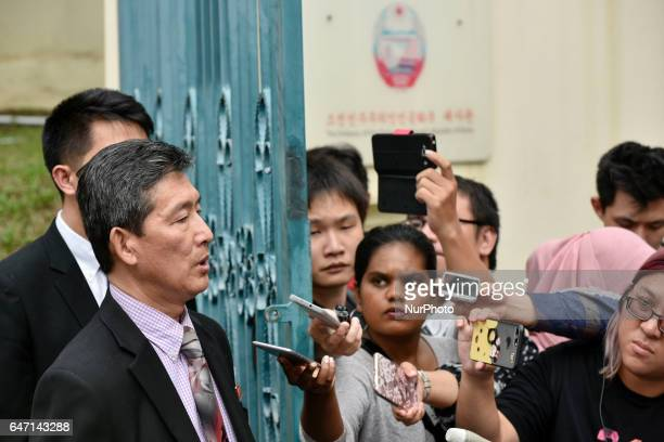 Former North Korean deputy ambassador to the United Nations Ri Tong Il gestures while reading a statement to journalists waiting outside the North...