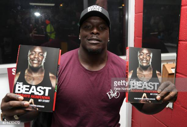 Former Northampton Town player Adebayo Akinfenwa with copies of his book 'The Beast' during a book signing at Sixfields on November 7 2017 in...