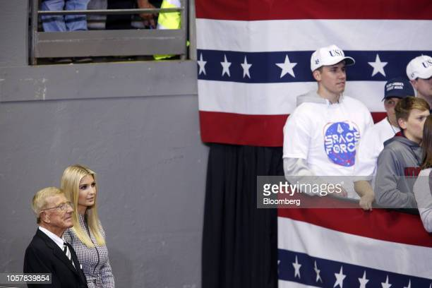 Former Notre Dame football coach Lou Holtz left and Ivanka Trump assistant to US President Donald Trump listen during a rally with President Trump in...