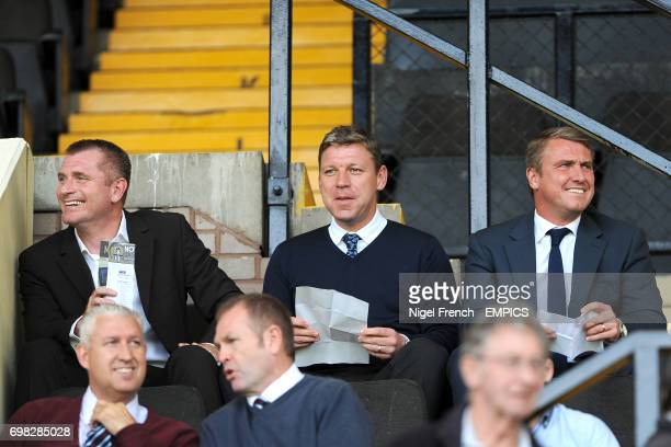 Former Notts County player Tommy Johnson Alan Thompson and Birmingham City manager Lee Clark in the stands at Meadow Lane