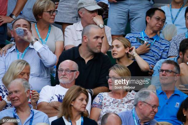 Former NRL footballer Nate Myles and his partner actress Tessa James watch the women's singles final between Caroline Wozniacki of Denmark and Simona...