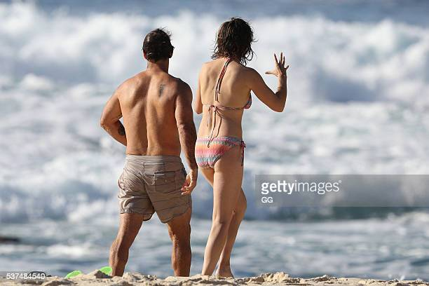 Former NRL player Andrew Johns displays his surfing skills while on a beach outing with a female friend on May 24 2016 in Sydney Australia
