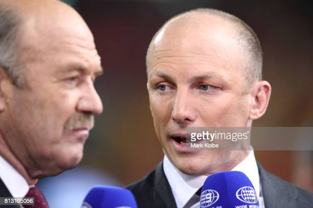 Former NRL player Darren Lockyer talks to Wally Lewis before game three of the State Of Origin series between the Queensland Maroons and the New...