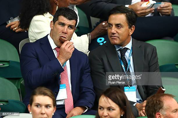 Former NRL player Michael Ennis watches the second round match between Lucie Safarova of the Czech Republic and Serena Williams of the United States...