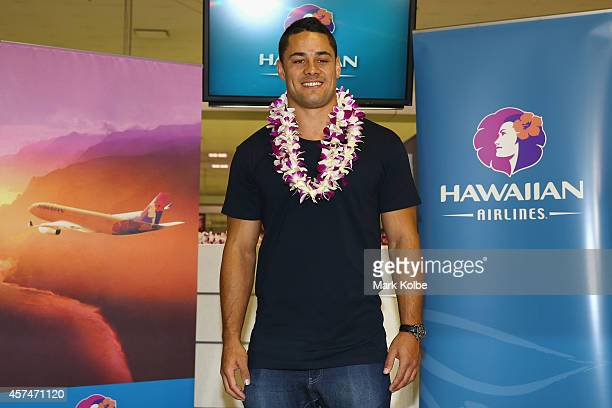 Former NRL Rugby League player Jarryd Hayne poses at the checkin counters at Sydney International Airport on October 19 2014 in Sydney Australia...