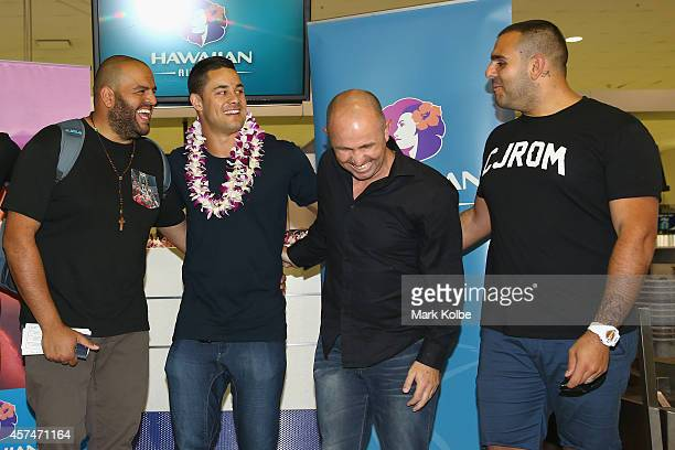 Former NRL Rugby League player Jarryd Hayne shares a joke with his travel companions as he poses at the checkin counters at Sydney International...