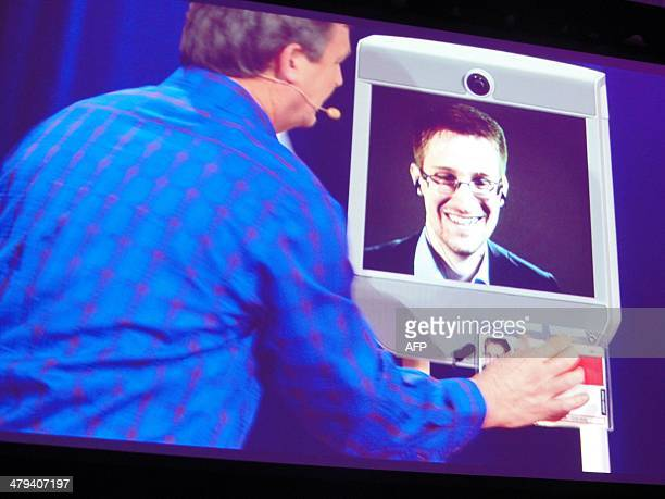 Former NSA contractor Edward Snowden appears by remotecontrolled robot at a TED conference in Vancouver on March 18 2014 Snowden emerged from his...