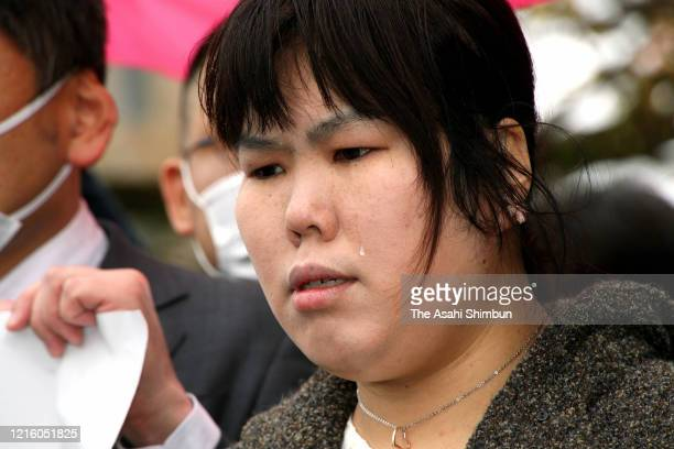Former nurse Mika Nishiyama, who was convicted of murder of a patient in 2003 and spent 12 years in prison, sheds tears with joy after the acquittal...