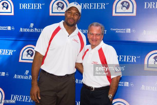 Former NY Giant Michael Strahan and attorney Marc Dreier pose at the 2008 Michael Strahan/Dreier LLP Charity Golf Tournament at Century Country Club...