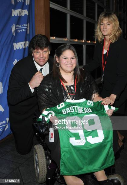Former NY Jets player Mark Gastineau and his wife Joann Gastineau present an autographed jersey to Sierra Acevedo at the Muscular Dystrophy...