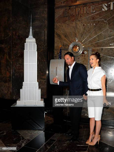 Former NY Met and 12 Time MLB AllStar Mike Piazza and his wife Alicia Rickter light The Empire State Building in Red White and Green to celebrate the...