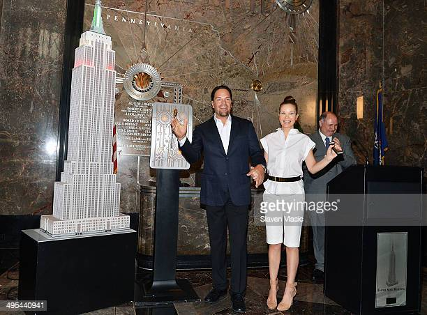 Former NY Met and 12 Time MLB AllStar Mike Piazza and wife Alicia Rickter light The Empire State Building in Red White and Green to celebrate the...