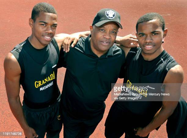 Former Oakland Raiders football player George Atkinson center stands with his two twin sons George III left and Josh right in Livermore Calif on...