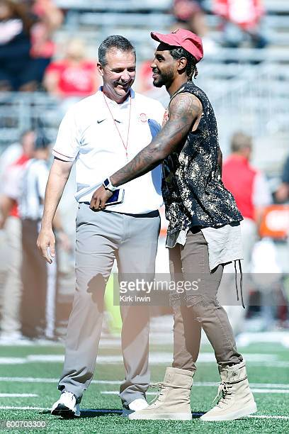 Former Ohio State Buckeyes player Braxton Miller of the Houston Texans talks with Head Coach Urban Meyer of the Ohio State Buckeyes prior to the...
