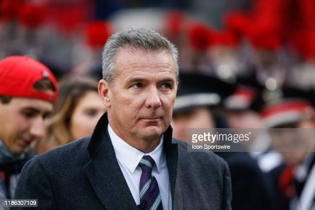 Former Ohio State head coach and current FOX Sports broadcast analyst Urban Meyer is seen on the sideline during a regular season Big 10 Conference...
